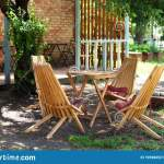 Wooden Furniture Set For Picnic In Garden Empty Sun Loungers And Table On Veranda Of House In Forest Outdoor Furniture For Leisu Stock Image Image Of Design Garden 195986521