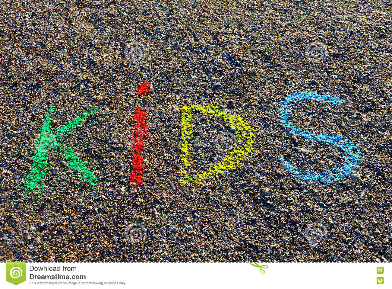 Word Kids Written With Colorful Crayons On The Asphalt