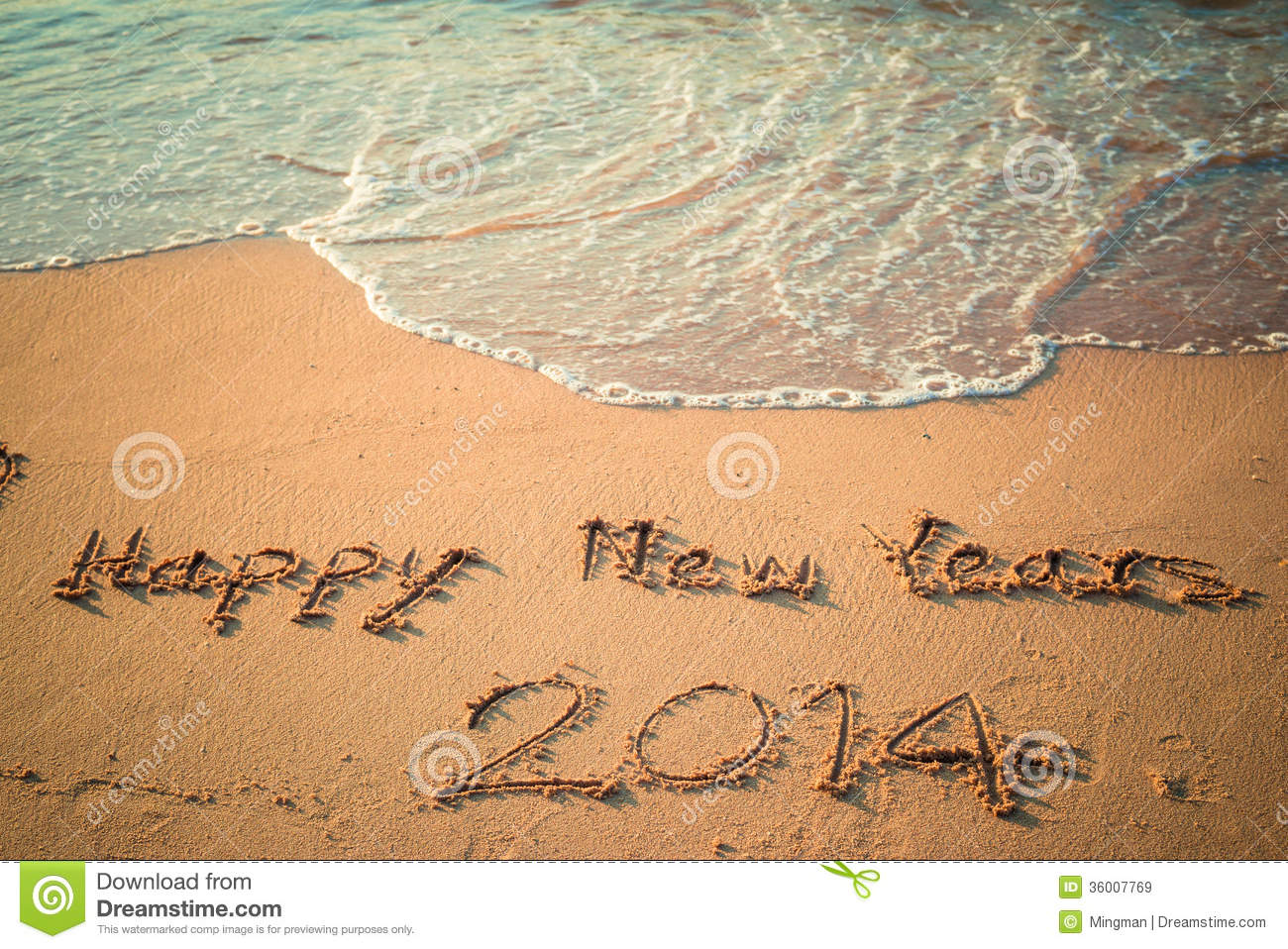 Writing Happy New Year S On The Beach Royalty Free Stock Images