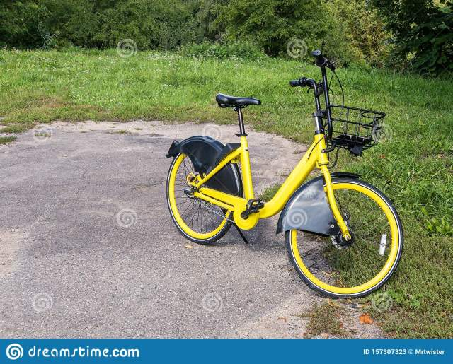 Yellow City Bike Parked On Grass. Bicycle Ready For ...