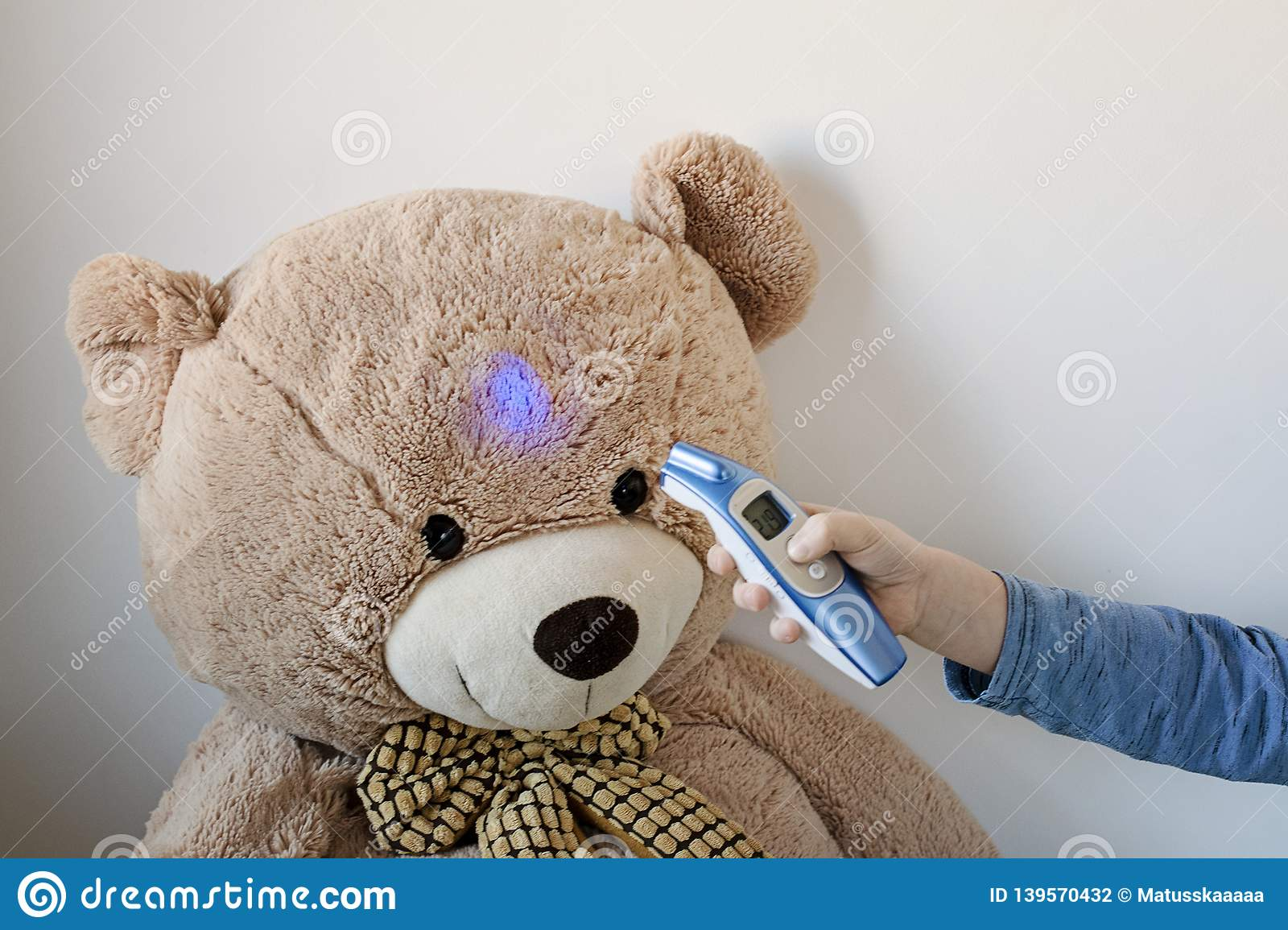 Young Boy Is Looking After His Sick Teddy Bear Boy Is