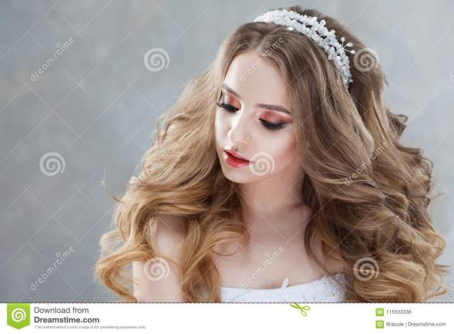young beautiful bride with luxurious curls. wedding