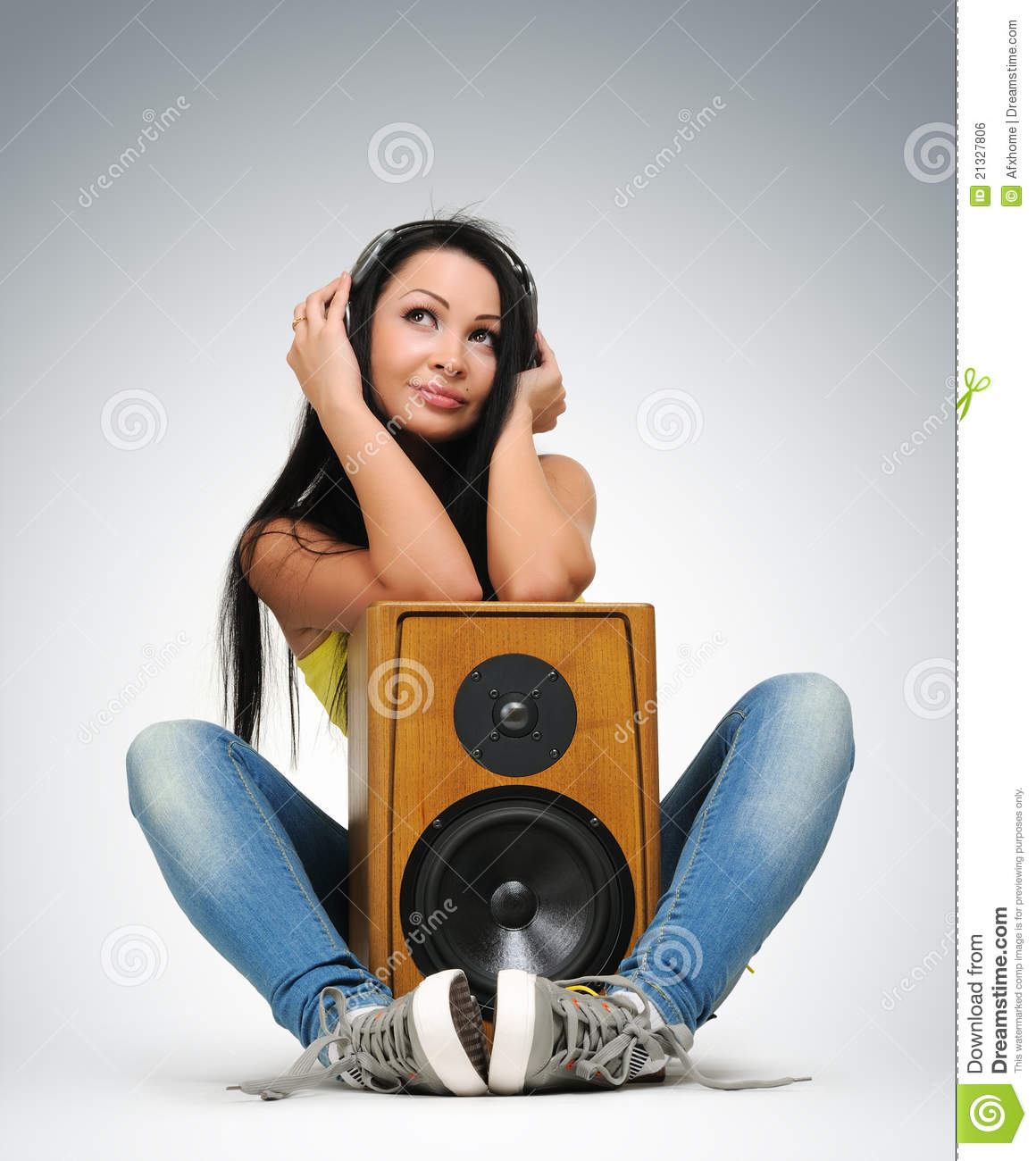 Young Beautiful Girl In Headphones With Speaker Royalty