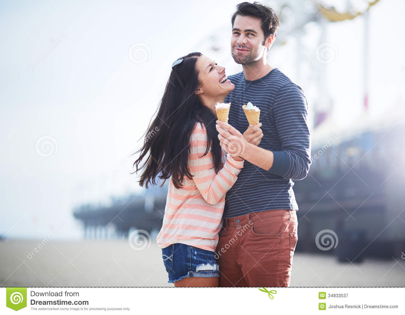 Young Couple Having Fun At Santa Monica Pier Royalty Free