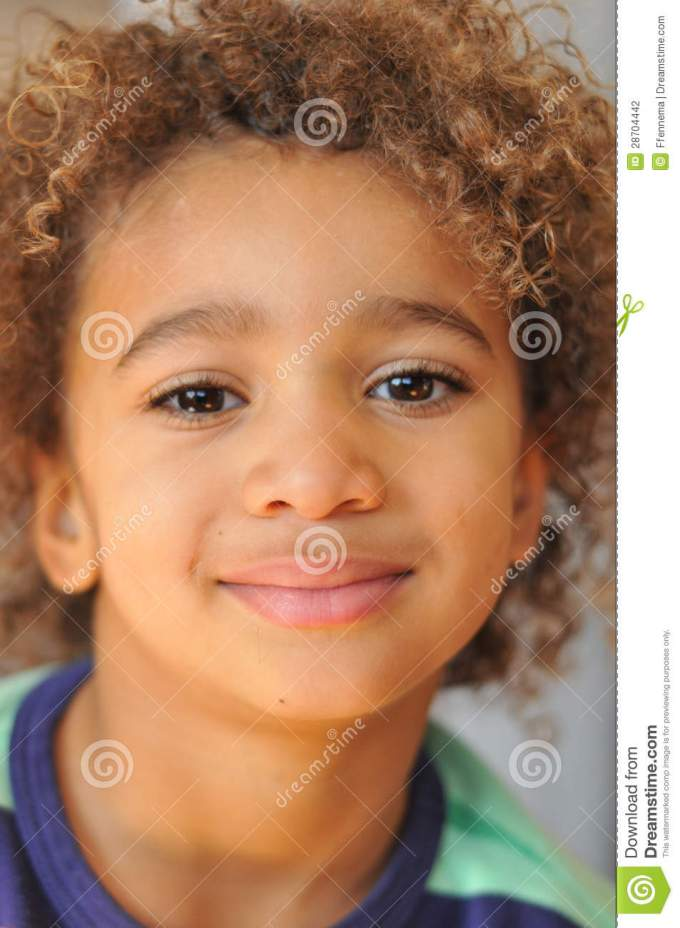 young mixed race boy with curly hair stock photo - image of