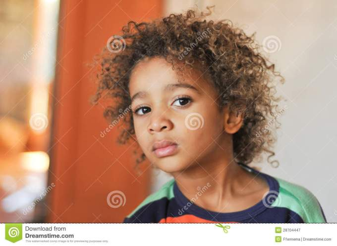 young mixed race boy with curly hair stock image - image of