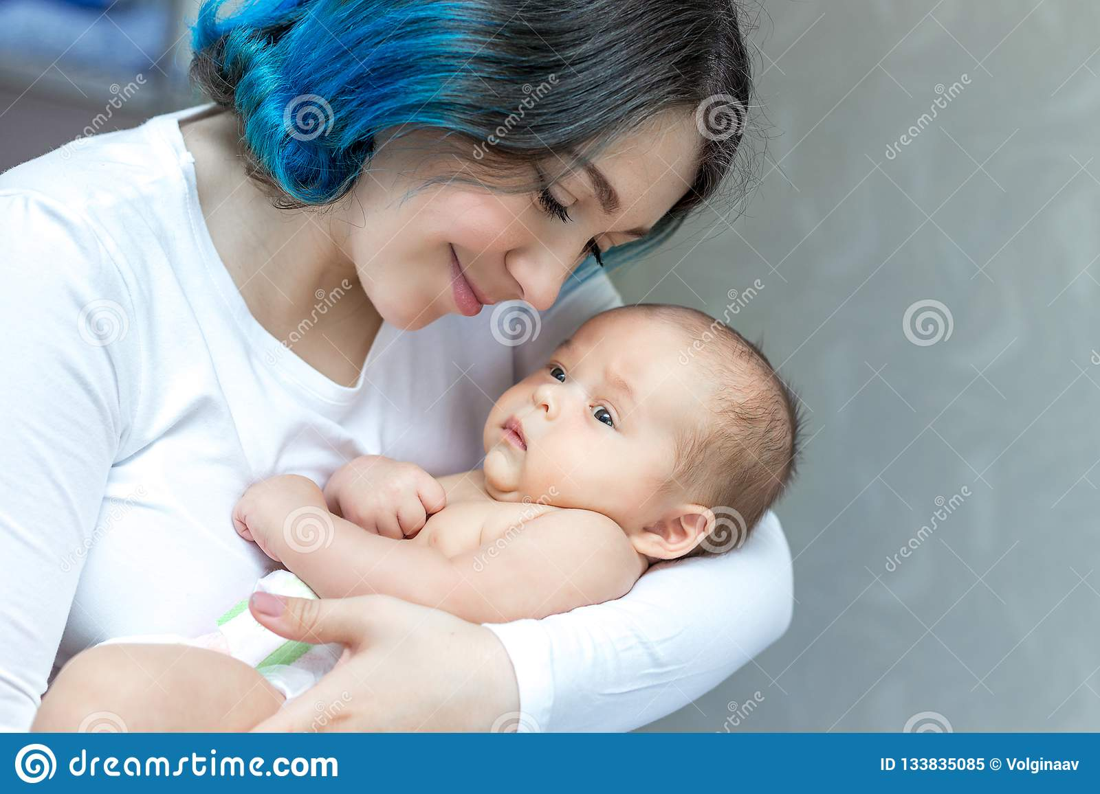 Young Mother Holding Her Newborn Child Mom Nursing Baby