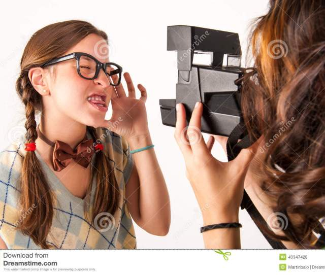 Young Nerdy Girls Using Instant Camera