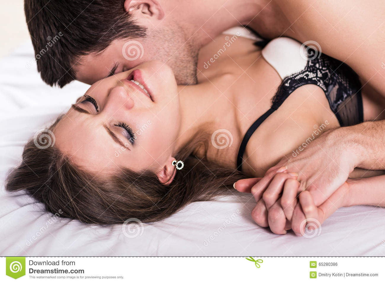 Kissing Romantically In Bed