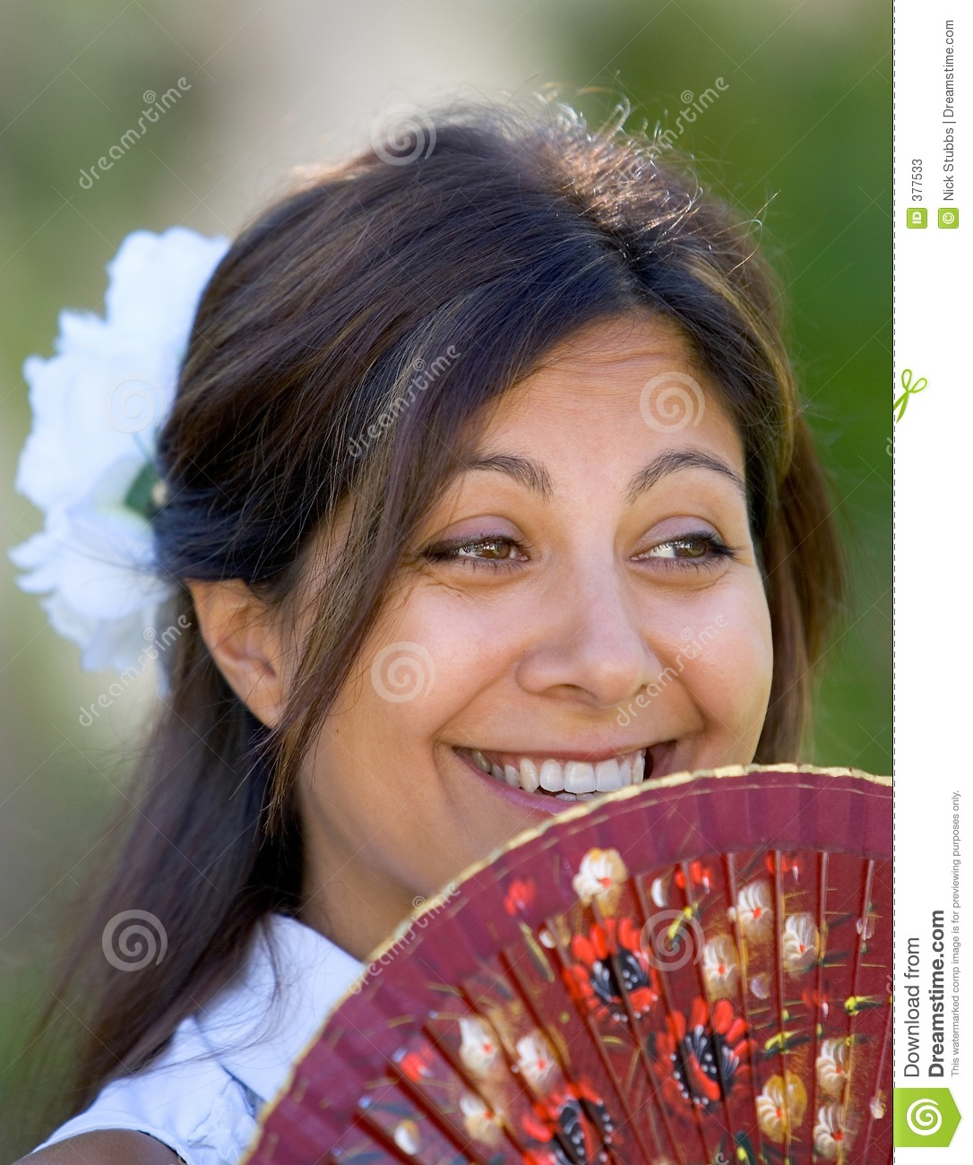 Young Spanish Girl Or Woman Smiling At Camera Holding