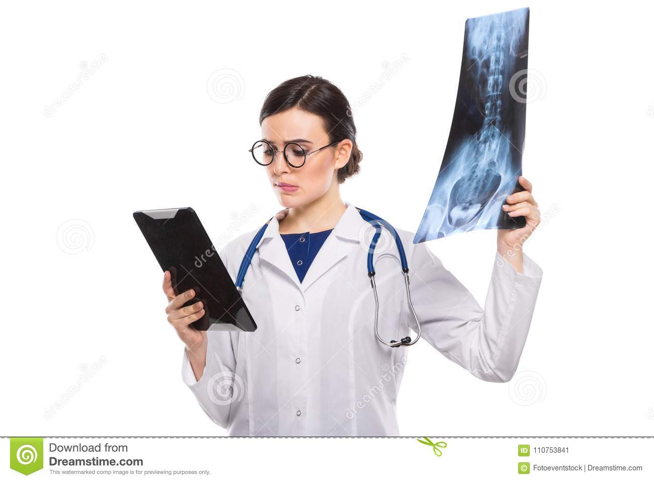 Young Woman Doctor With Stethoscope Looking At X Ray