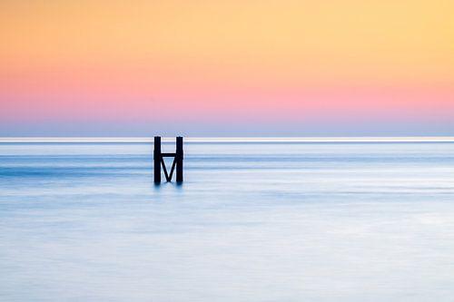 Het havenhoofd van Westkapelle tijdens zonsondergang
