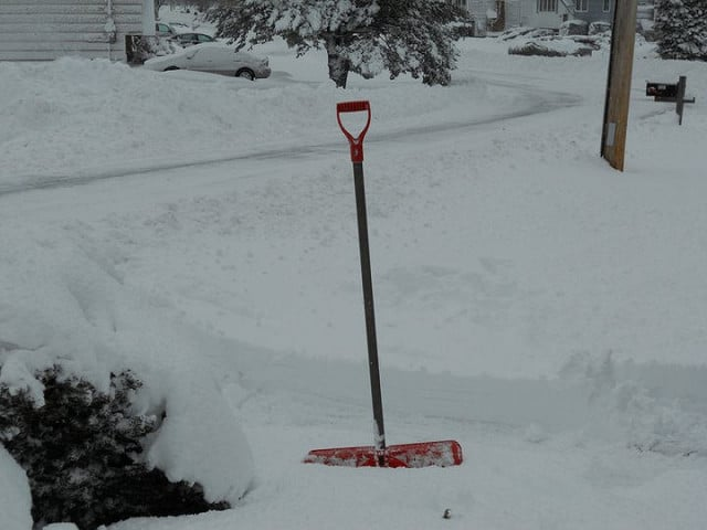 Snow Shovel in the Snow - Cold Weather Emergency