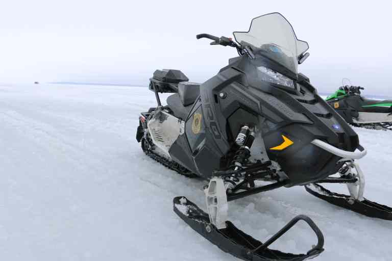 Snowmobile Though Ice