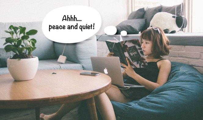 girl reading book in living room alone