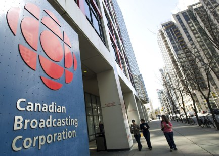 People walk into the CBC building in Toronto on Wednesday, April 4, 2012. CBC/Radio-Canada has announced that it will have to cut 650 jobs over the next three years. THE CANADIAN PRESS/Nathan Denette