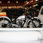 A Harley Hummer mixed in with the Car Show