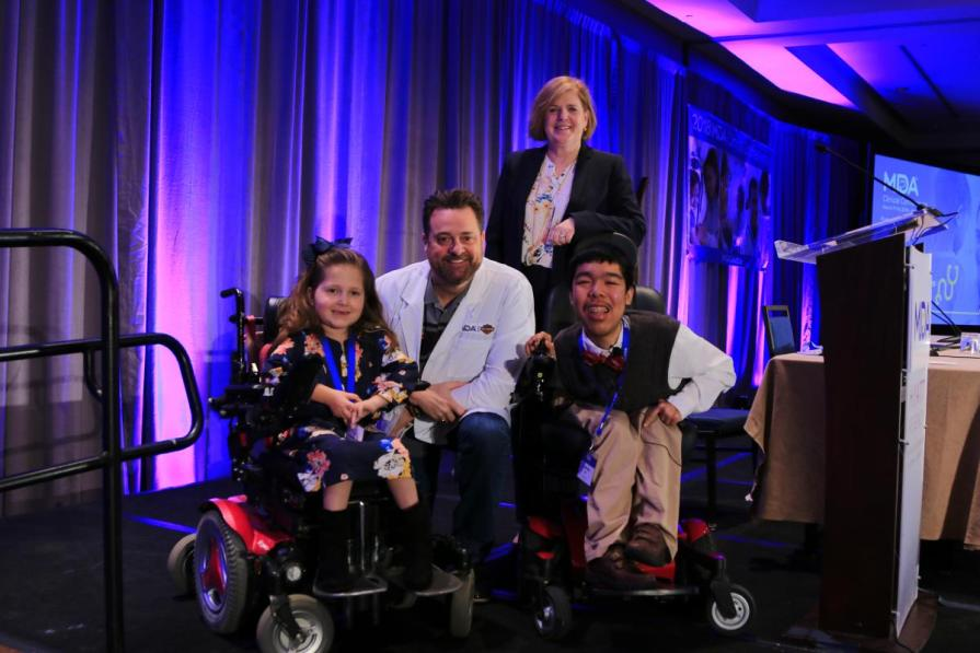 Milwaukee-based Harley-Davidson, Inc. was honored with a special award during the 2018 MDA Clinical Conference in Arlington, VA on Monday, to recognize the company's fundraising efforts for MDA's research program. Left to right: MDA National Ambassador Faith Fortenberry, Harley-Davidson Director of Government Affairs Ed Moreland, MDA President and CEO Lynn Vos and MDA National Ambassador Justin Moy.