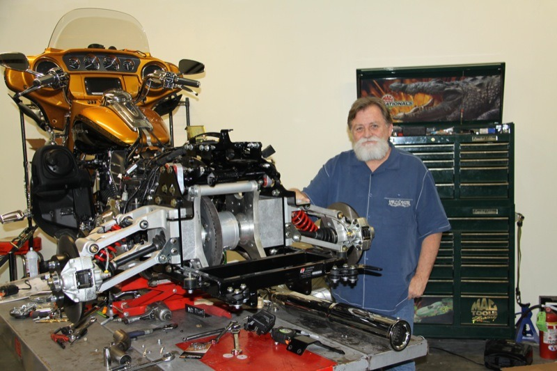 Certifi ed trike conversion specialist Randall Johnston and the 2015 CVO Ultra undergoing a facelift