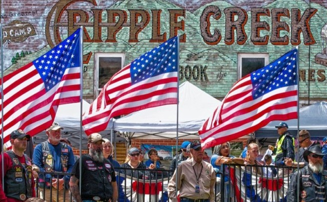 Volunteer honor guards bearing US Flags at the POW/MIA Ceremony in downtown Cripple Creek, Colorado