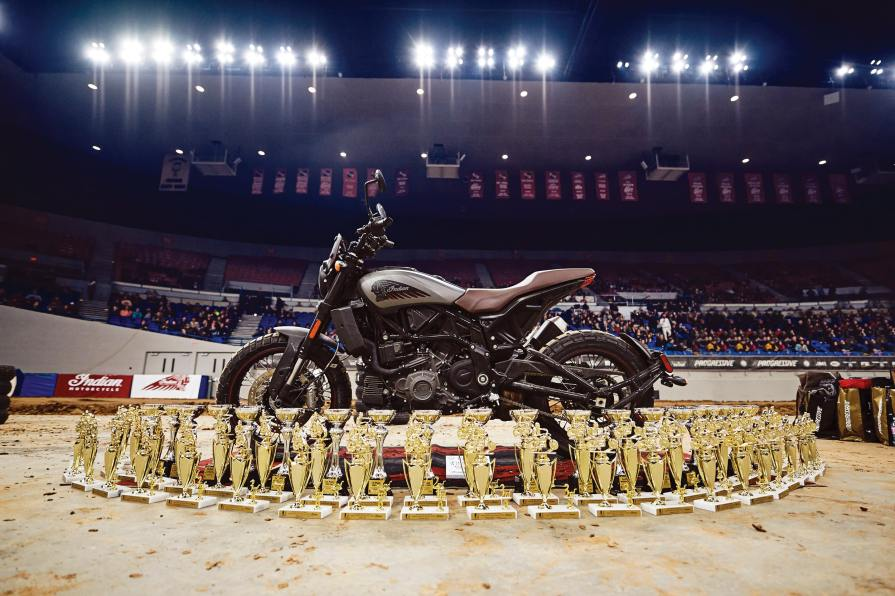 Racing trophies surround an Indian FTR1200 in the Coliseum, while local Portland heavy metal band Red Fang Band (above) entertained the folks in a particularly high-volume way.