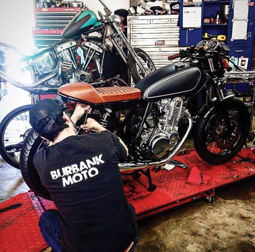 Ritchie from Wilder Factory installs one of his seats on our SR400 build.