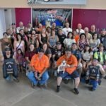 Magic Valley Rider volunteers take time out from their busy activities for a group photo before the official beginning of the 9th Annual Beach-N-Biker Fest