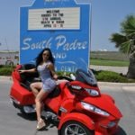 Playboy cyber girl and Glitz Doll Sheena Lee puts on an impromptu photo shoot aboard the Can-Am Spyder Roadster RT