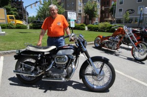 Eddie Provencal proudly shows his 1966 XLCH at the historic train station in downtown Laconia