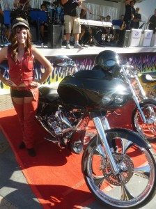 Roadshows showgirl Heather Galick poses with the winning bike of the Chopper/Custom-built class
