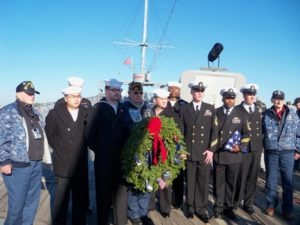 "Veteran Cody ""Spider"" Pasieka of Maine presents a wreath aboard the U.S.S. New Jersey"