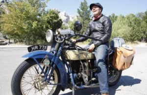 Sculptor Jeff Decker playfully hopped aboard buddy Rick Salisbury's Henderson during a stop at historic Mount Rushmore. Decker and Salisbury enjoyed sharing lanes through the Badlands and twisties of South Dakota.