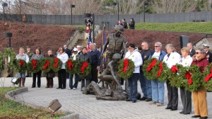 Gold Star families from New Jersey are presented with wreaths during the ceremony at the Vietnam Memorial in Holmdel, New Jersey