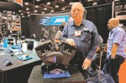 Jim Thiessen displays the Forceflow  Cylinder Head Cooler that won the Accessory of the Year award for JIMS Machining