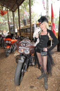Dante and Diva Dawn, who had her Metal di Muse jewelry and accessorie​s stand set up at the Broken Spoke, check out the bike show