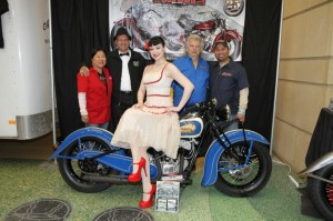 "Model Betsey McKenzie (foreground) with Carolyn and ""Kiwi"" Mike Tomas of Kiwi Indian Motorcycle Company, Donnie Smith, and Art Welch of Indian Motorcycle of the Twin Cities"