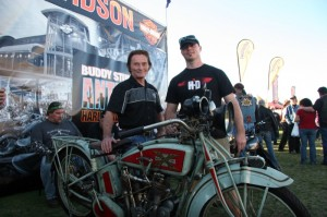 Buddy Stubbs shows off his Excelsior, ridden during the 2010 Motorcycle Cannonball, as his son Jack looks on