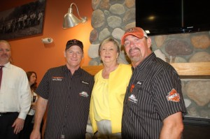 Harley-Davidson of PCB owners Preston Foster (l) and Gary Bang Jr. receive a warm welcome from PCB Mayor Gayle Oberst