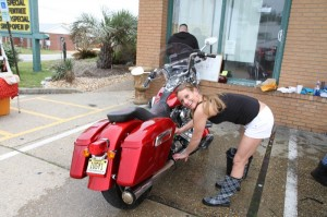 The lovely Lynn cleans the grime off my FLD at the Port O'Call charity bike wash