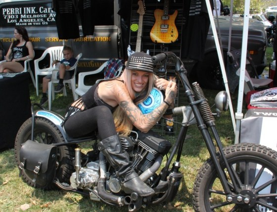 Misi Perri of Perri Ink Cartel gets cozy with one of their customs