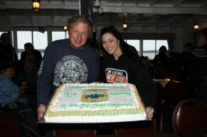 Charlie St. Clair, executive director of the Laconia Motorcycle Week Association, and Jennifer Anderson, director, celebrate the rally's 90th anniversary... with cake!