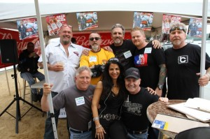 Cynthia Makris (front center) surrounded by the distinguished judges for the NASWA's Miss Laconia Motorcycle Week Bikini Contest