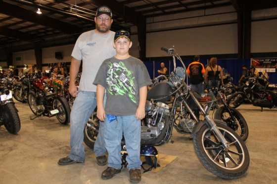 Jarrad and Jacob Haddix stand with their custom '68 Sportster