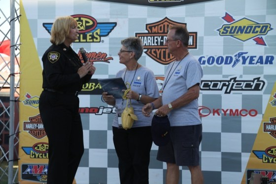 Chaplain Russell presents a plaque to Mary Ann and Will Tonn at the Sacramento Mile