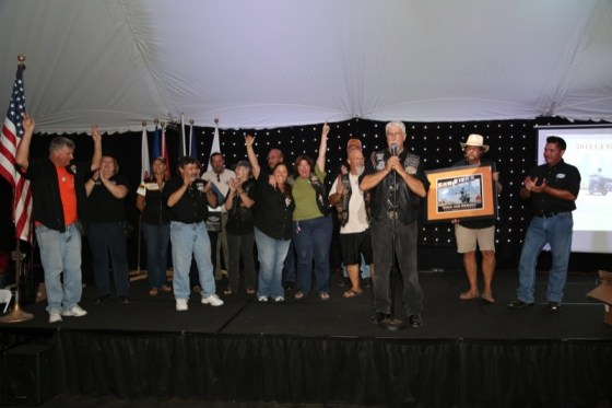 """Keith """"Coffee"""" Kaufman announces raffle and award winners at Party Pals"""