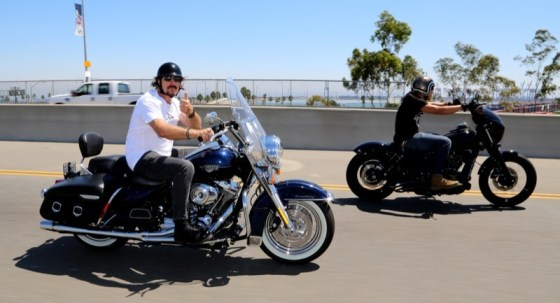 Kim Coates flies a thumbs up as Theo Rossi hammers the throttle en route to the Battleship U.S.S. Iowa