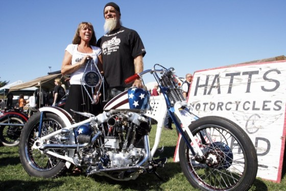 Bike builder Bret Hatt and his lovely bride pose with their Best of Show-winning Knucklehead