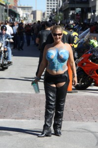 """This gal was proud to display a different type of """"twins"""" to folks along The Strand"""