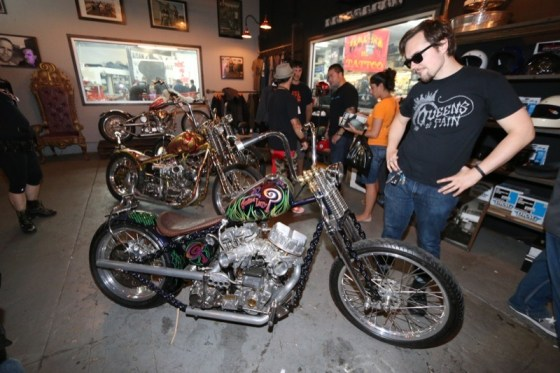 Visitors admire the Indian Larry customs in the retail side of the shop