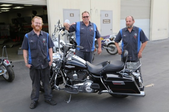 Palm Springs Harley service techs Alan Lamb, and Paul Boughey with Service Manager Lonnie Reddick (center) and the author's Road King